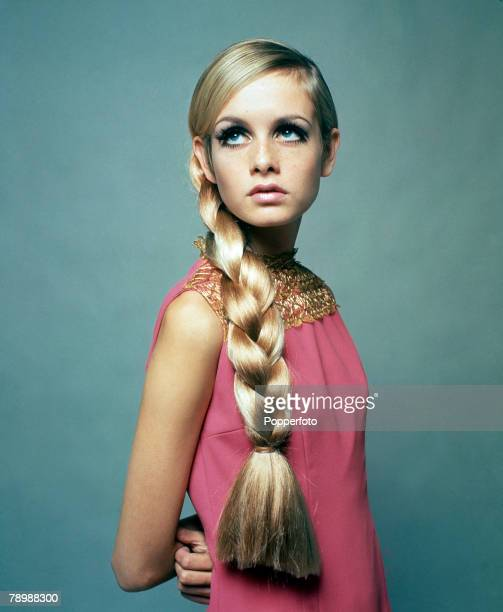 Fashion England 3rd December 1966 A portrait of model Twiggy wearing a fashionable pink dress and a large plat in her long hair whilst looking...