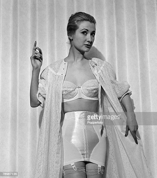 Fashion England A model wearing wearing a light coloured corset and bra