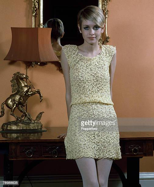 Fashion England Model Twiggy wearing a knitted mini dress