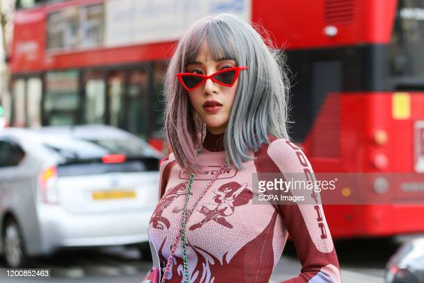 Fashion enthusiast attends day one of the London Fashion Week - Autumn/Winter collection fashion show at The Strand in London.