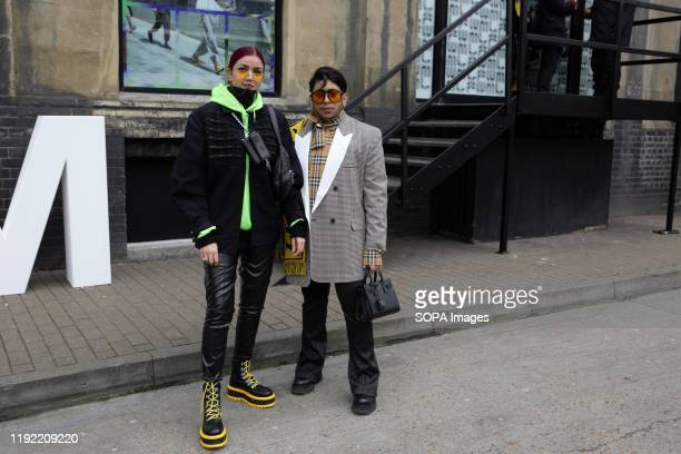 Fashion Enthusiasts wearing fashionable outfits attend the London Fashion Week Men's Day two Street Style