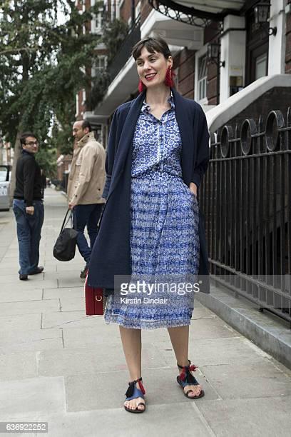 Fashion entrepreneur Maria Kastani wears Marc Jacobs coat, Mehry Mu bag, Kokoro shirt and skirt and vintage shoes on day 2 of London Womens Fashion...