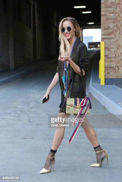 Fashion entrepreneur Marina Dobreva wearing a Zara dress with Gucci bag and Salvatore Ferragamo shoes attends the Spring/Summer 2018 womenswear...