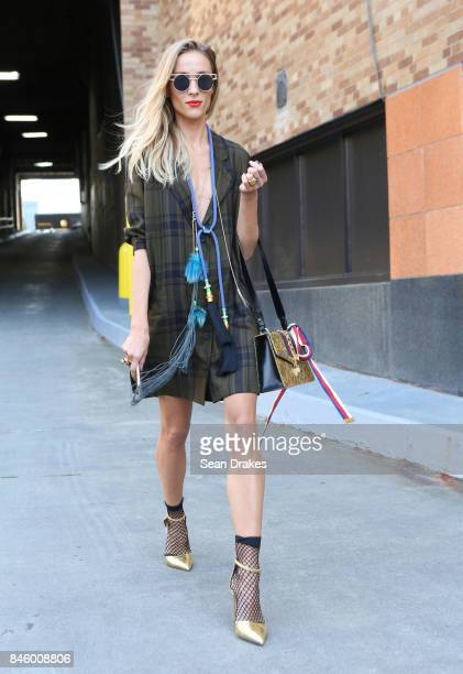 Fashion entrepreneur Marina Dobreva wearing a Zara dress with Gucci bag and Salvatore Ferragamo shoes attends the Spring/Summer 2018 womenswear...