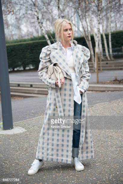 Fashion executive at Red magazine Sophie Hooper wears a Charlotte Zimbehl coat Zara shirt and bag Joe's Jeans jeans and Axel Arigato trainers on day...