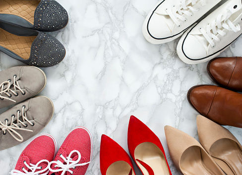 Fashion flatlay - variety of the colorful woman shoes on white, marble, elegant background. 865111460