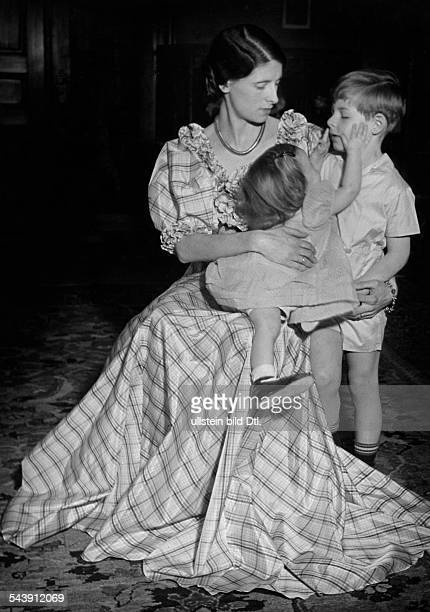 Fashion for mother and child woman in a larg taffeta dress children in taffeta clothes ca 1936 Photographer Hedda Walther Published by 'Die Dame'...