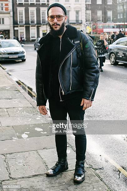 Fashion forecaster Antonio poses wearing vintage glasses a vintage jacket Maison Martin Margiela goody Topman trousers and Costume National shoes at...