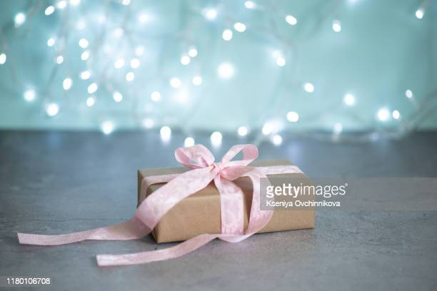 fashion gifts or presents boxes with golden bows and star confetti on pink pastel table top view. flat lay composition for birthday, christmas or wedding. - wedding background stock pictures, royalty-free photos & images