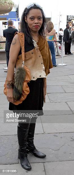 Fashion goer poses for a picture during the Olympus Fashion Week Spring 2005 at Bryant Park September 9, 2004 in New York City.