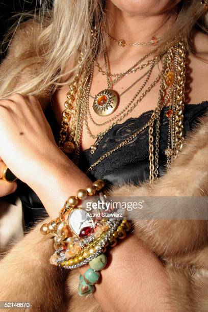 Fashion goer with a funky necklace poses for photos in the lobby of the main tent during Olympus Fashion Week Fall 2005 at Bryant Park February 6,...
