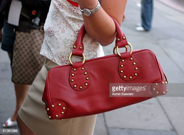 Fashion goers are seen during the Olympus Fashion Week Spring 2005 at Bryant Park September 9, 2004 in New York City.