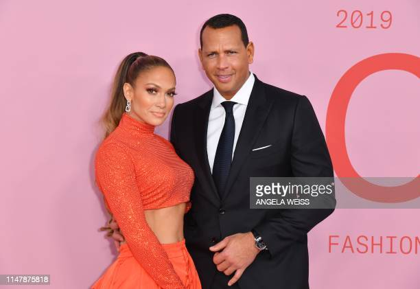 Fashion Icon Award recipient US singer Jennifer Lopez and fiance former baseball pro Alex Rodriguez arrive for the 2019 CFDA fashion awards at the...
