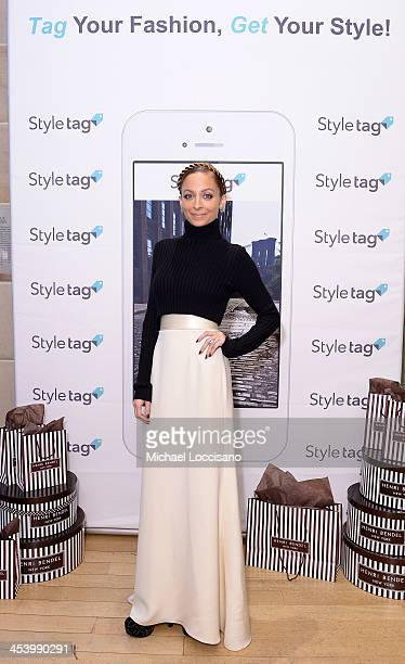 Fashion icon Nicole Richie poses at the launch of Styletag at Henri Bendel on December 6 2013 in New York City