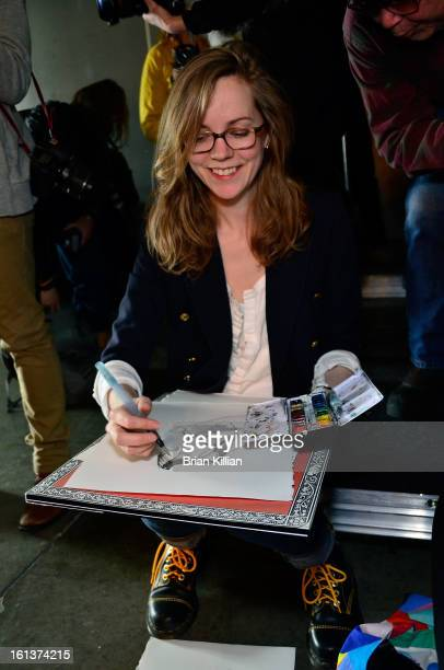 Fashion illustrator Danielle Meder attends Jeremy Laing during Fall 2013 MercedesBenz Fashion Week at Pier 59 Studios on February 10 2013 in New York...