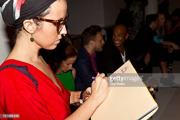 Fashion illustrator Jessika Repetto attends the Suno spring 2013 fashion show during MercedesBenz Fashion Week at Milk Studios on September 7 2012 in...