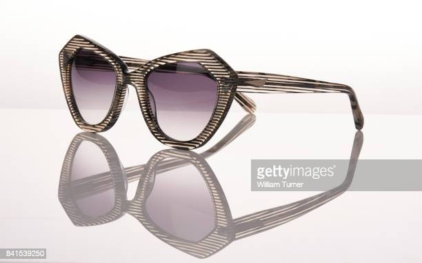 A fashion image of sunglasses on a white background