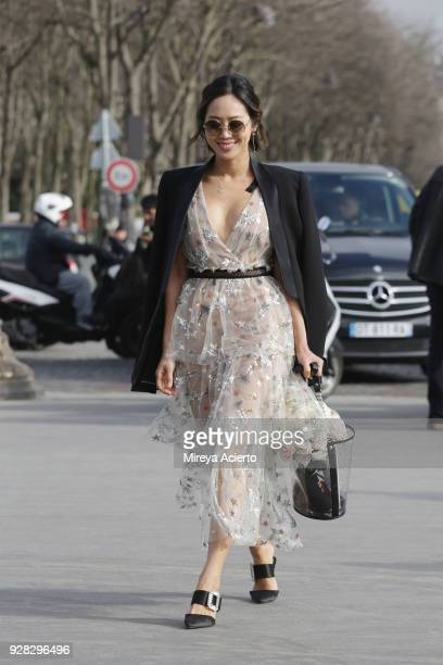Fashion influencer Aimee Song seen wearing Chanel at the Chanel fashion show during Paris Fashion Week Womenswear Fall/Winter 2018/2019 on March 6...