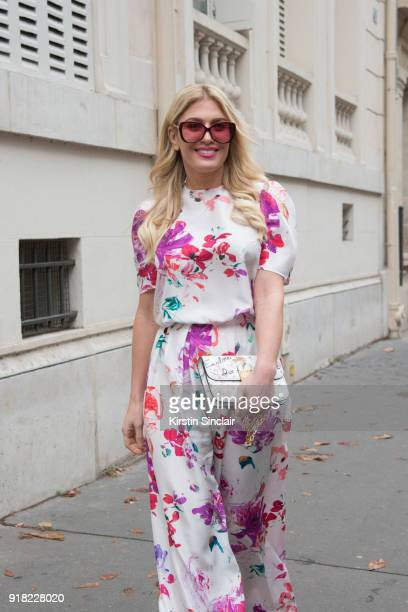 Fashion influencer and TV presenter Hofit Golan wears an Emanuel Ungaro jumpsuit and a Dior bag day 6 of Paris Womens Fashion Week Spring/Summer 2018...