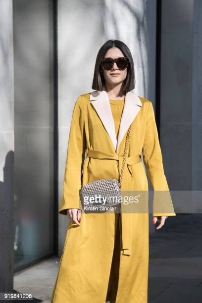 Fashion influencer Anisa Sojka wears a Stine Goya suit Bimba Y Lola bag Quay sunglasses on day one of London Womens Fashion Week Autumn/Winter 2018...