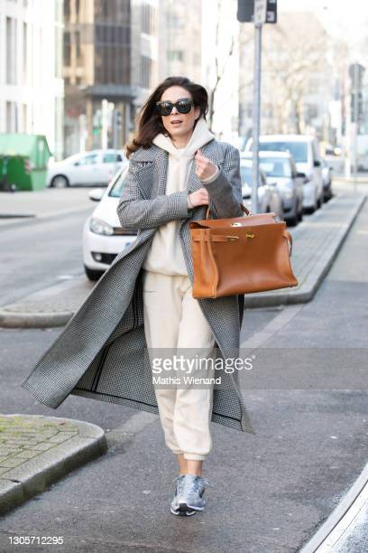 Fashion Influencer, art historian and CEO of high10art Patricia Wirschke is seen wearing the Pangaia suit, Tagliatore coat, Nike shoes, Hermes bag,...