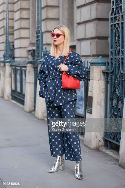 Fashion influencer Emily Hart Valentine wears an HM top and trousers Bershka sunglasses Esin Akan bag New Look boots on day one of London Womens...