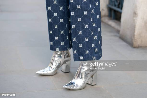 Fashion influencer Emily Hart Valentine wears an HM trousers and New Look boots on day one of London Womens Fashion Week Autumn/Winter 2018 on...