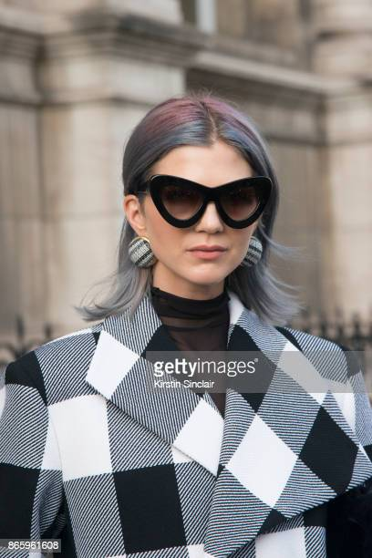 Fashion influencer Samantha Angelo of The Eye Travels wears a Marques Almeida coat, Sunday Somewhere sunglasses and Balenciaga earrings day 2 of...