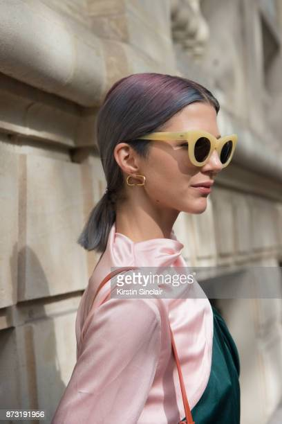 Fashion influencer Samantha Angelo of The Eye Travels wears a Mouse top Sunbuddies sunglasses and Maria Black earrings day 4 of Paris Womens Fashion...