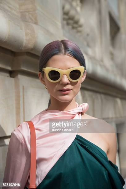 Fashion influencer Samantha Angelo of The Eye Travels wears a Mouse top, Sunbuddies sunglasses and Maria Black earrings day 4 of Paris Womens Fashion...