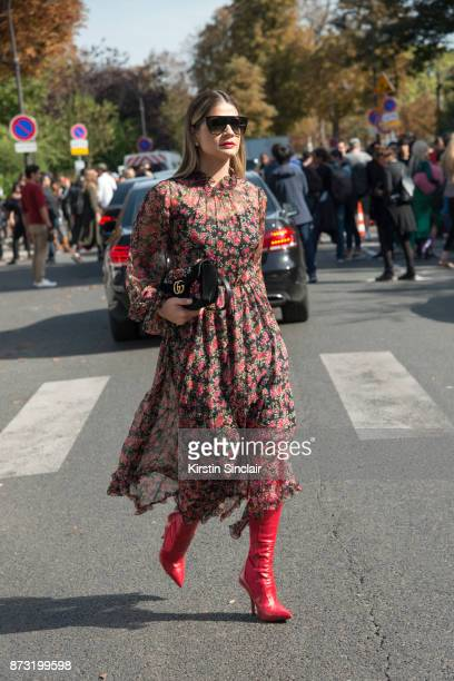 Fashion influencer Tassia Naves wears a Dolce Gabbana dress Fendi shoes Gucci bag and Celine sunglasses day 4 of Paris Womens Fashion Week...