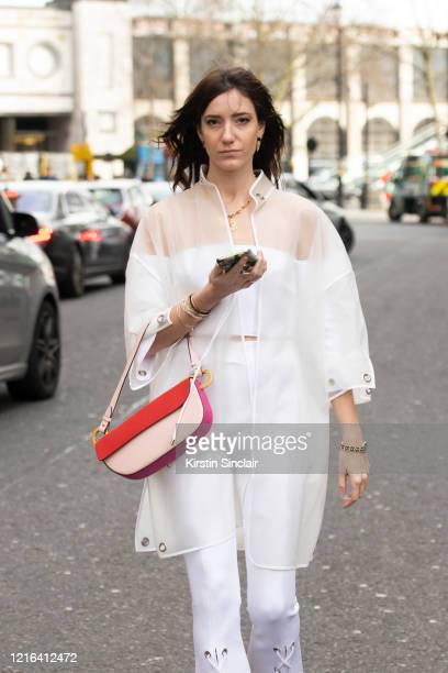 Fashion influencer Victoria Gasperi wears a Nico Giani bag and Marine Henrion top trousers and jacket during London Fashion Week February 2020 on...