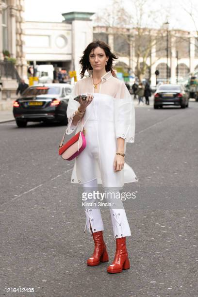 Fashion influencer Victoria Gasperi wears a Nico Giani bag Nodaleto boots and Marine Henrion top trousers and jacket during London Fashion Week...