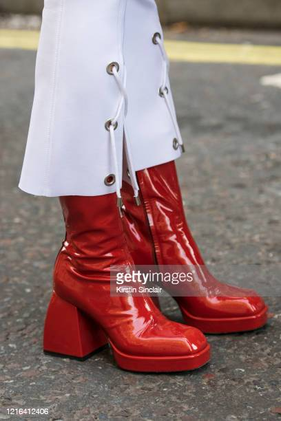 Fashion influencer Victoria Gasperi wears Nodaleto boots and Marine Henrion trousers during London Fashion Week February 2020 on February 18 2020 in...