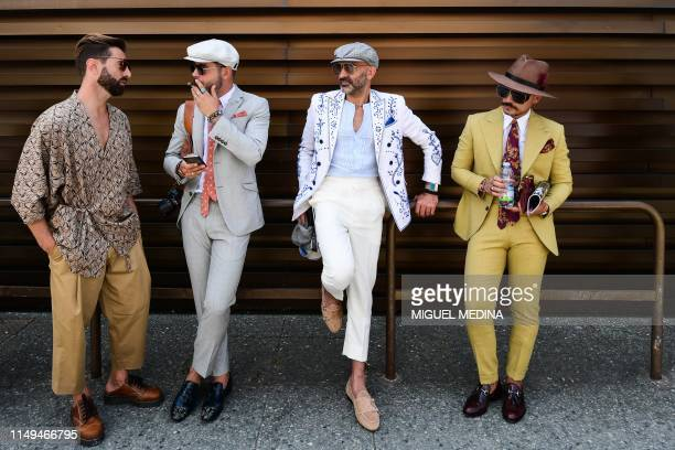 Fashion influencers attend the Pitti Immagine Uomo fashion event on June 12 2019 in Florence Tuscany