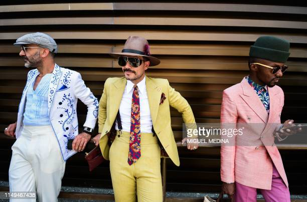 Fashion influencers attend the Pitti Immagine Uomo fashion event on June 12, 2019 in Florence, Tuscany.