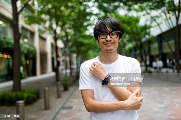 fashion japanese adult man walking - japanese culture stock pictures, royalty-free photos & images