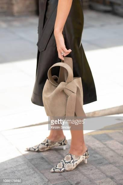 Fashion Journalist and digital influencer Monica de la Villardiere wears a Petar Petrov skirt Rejina Pyo shoes Acne bag during London Fashion Week...