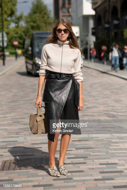 Fashion Journalist and digital influencer Monica de la Villardiere wears a Petar Petrov top and skirt Rejina Pyo shoes Acne bag and Joseph sunglasses...