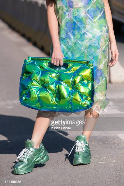 Fashion journalist and Digital Influencer Susie Lau wears a Margiela bag Paco Rabanne dress and Gucci trainers on February 27 2019 in Paris France