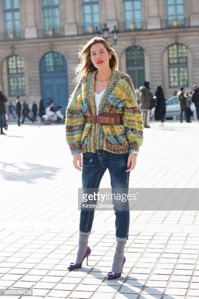Fashion journalist Carla Hinojosa wears a Las Antonias knit jumper Blumarine belt Prada shoes and Dsquared jeans day 3 of Paris Womens Fashion Week...