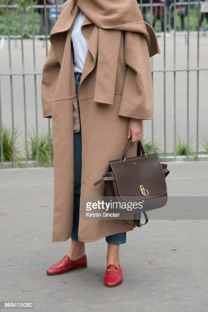Fashion journalist Darja Barannik wears a Mulberry bag, Toteme coat and Gucci shoes day 3 of Paris Womens Fashion Week Spring/Summer 2018, on...