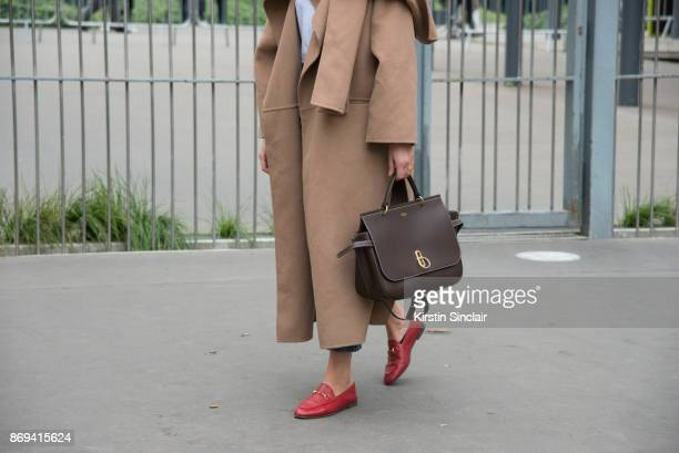 Fashion journalist Darja Barannik wears a Mulberry bag Toteme coat and Gucci shoes day 3 of Paris Womens Fashion Week Spring/Summer 2018 on September...