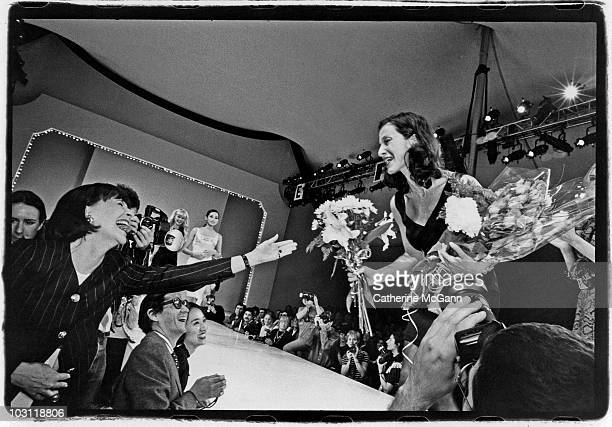 Fashion journalist Elsa Klensch congratulates American fashion designer Cynthia Rowley at a show of Rowley's fashions in the 1990s in New York City...