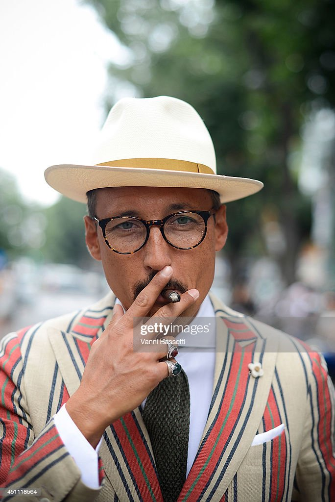 Fashion journalist Fabrizio Oriani is seen wearing a Lardini jacket and Progetto Fede rings after Gucci show on June 23, 2014 in Milan, Italy.