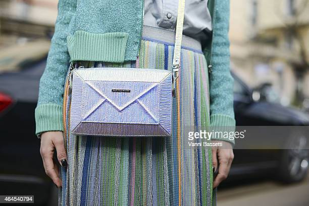 Fashion journalist Kasia Ayerden poses wearing Sabrina Pilewicz bag and Missoni jacket and Skirt on February 26 2015 in Milan Italy