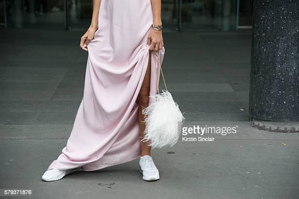 Fashion journalist Milana Koroleva wears an Isetta dress Elie Saab bag and Nike sneakers day 4 of Paris Haute Couture Fashion Week Autumn/Winter 2016...