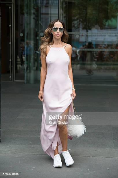 Fashion journalist Milana Koroleva wears an Isetta dress Elie Saab bag Dior sunglasses and Nike sneakers day 4 of Paris Haute Couture Fashion Week...