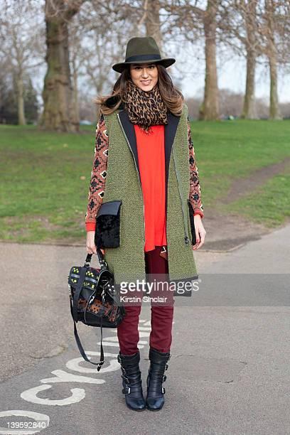 Fashion Journalist Soraya Bakhtiar wearing a Forever 21 hat Proenza Schouler bag Phillip Lim jacket Over caot Opening Ceremony Louis Vuitton scarf...