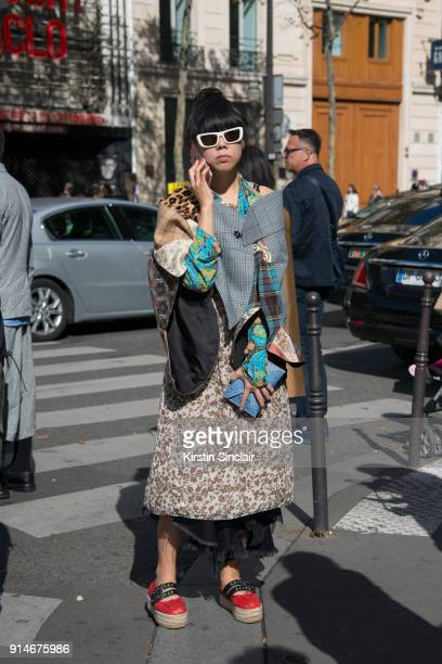 Fashion journalist Susie Lau wears a Marine Serre jacket Miu Miu shoes and Creatures of the wind sunglasses day 5 of Paris Womens Fashion Week...